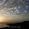 sun spreads confetti clouds